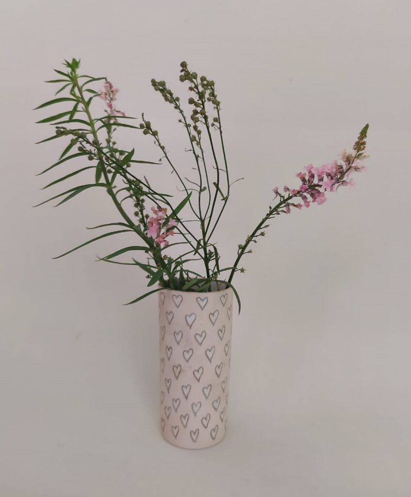 Porcelain vase with flowers